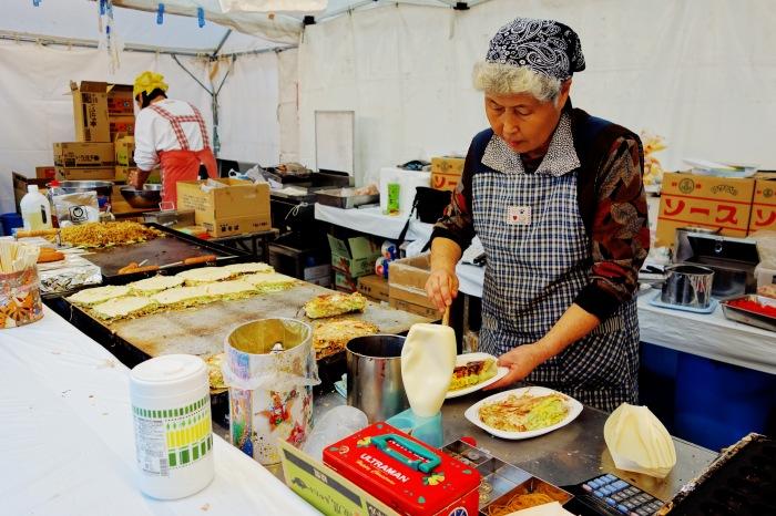 Oba-chan preparing okonomiyaki